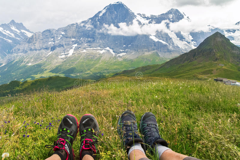 Tourists legs with mountain background, hiking in Alps, Switzerland royalty free stock photo