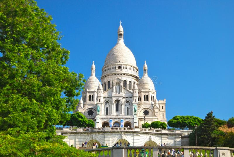 Paris Sacre Coeur Montmartre Church Basilica Sacred Heart. Tourists line the walkways of Sacre-coeur de Paris à Montmarte - The Basilica of the Sacred Heart stock image