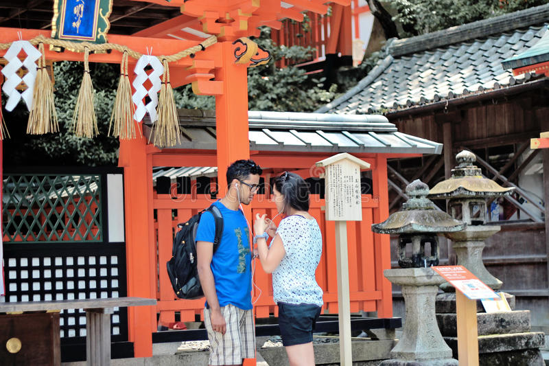 Tourists listen to music, share the love,within shrine . royalty free stock photo
