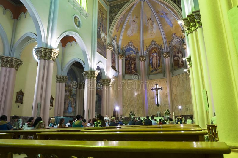 Tourists and local people at the Sunday mass in Church of the Holy Redeemer. In Bari city from Italy stock image