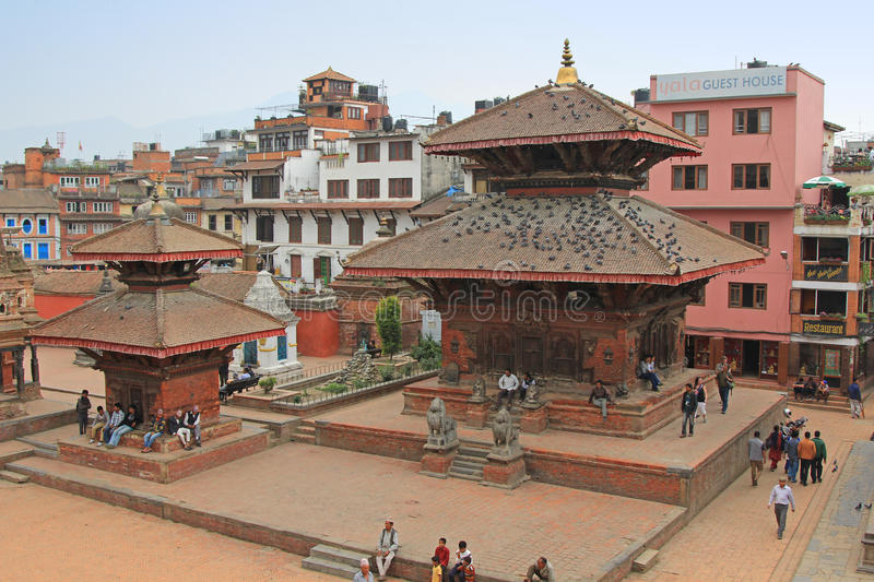 Tourists and local people visiting Patan Durbar Square in Nepal. PATAN, NEPAL - APRIL 2014 : Tourists and local people visiting Patan Durbar Square in Patan royalty free stock photos