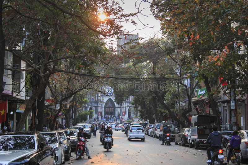 Tourists and local people walking in fron of Saint Joseph Cathedral, the most important church of Hanoi. Hanoi, Vietnam: February 21, 2016: Tourists and local stock photos