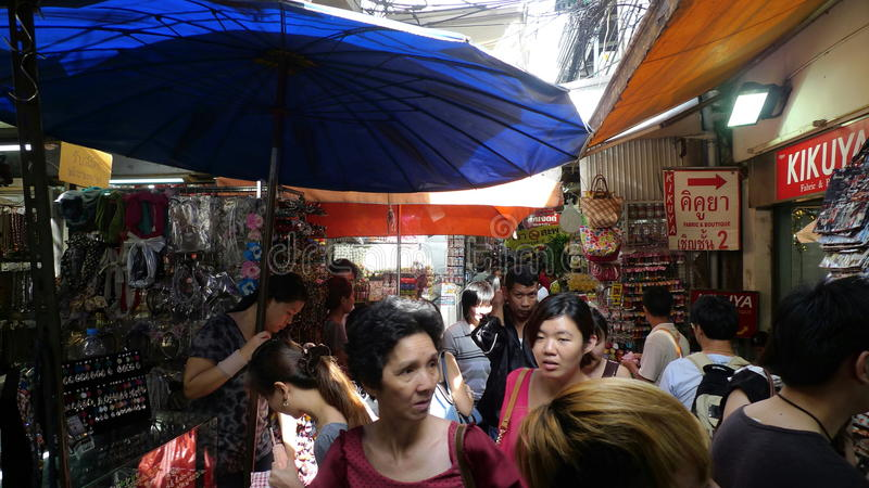 Tourists and Locals at Chatuchak weekend market. Bangkok, Thailand- June 10, 2016: Chatuchak weekend market in Bangkok, Thailand. It is the largest market in stock photo