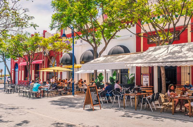 Tourists and locals enjoy the alfresco dining in restaurants in Plaza La Lota, including the successful newly relocated LPA The stock photography