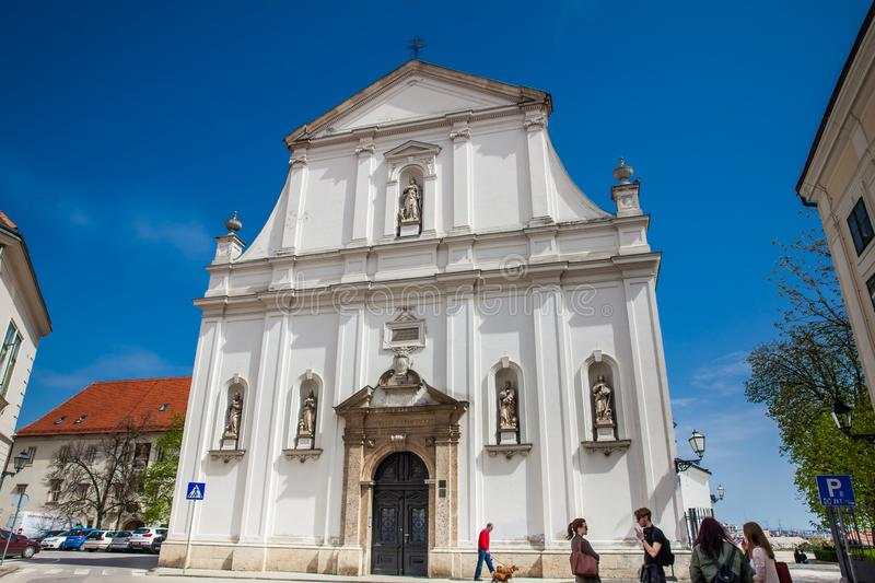 Tourists and locals at the Historical Saint Catherine of Alexandria church completed in 1632 in stock photos
