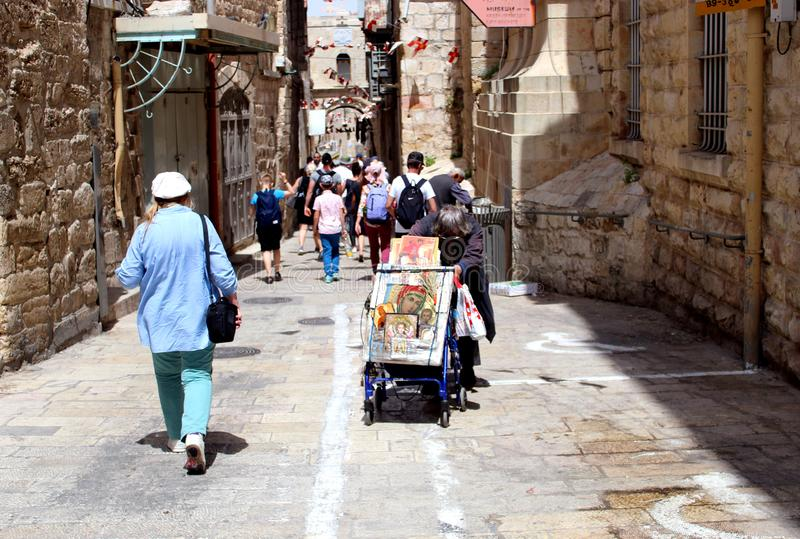 Tourists and locals in the old city stock photo