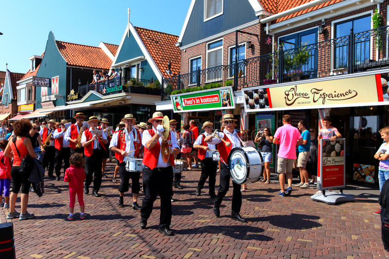 Tourists and locals at Volendam's boardwalk. stock images