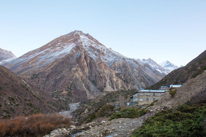 Tourists lodge on the Annapurna circuit trek with snowy mountains royalty free stock photo