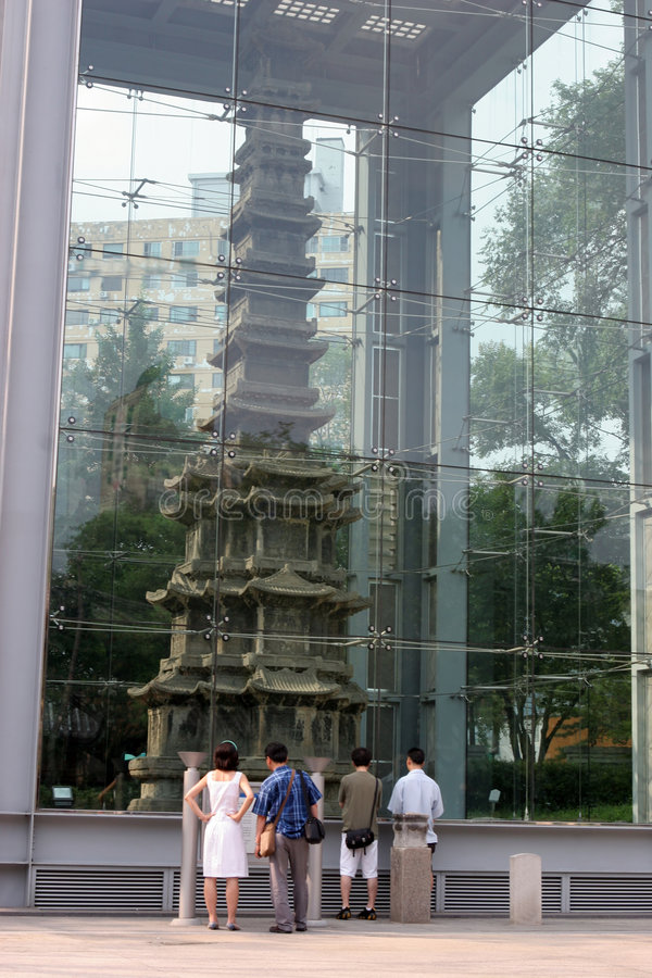 Tourists look at a Buddhist structure - travel and tourism royalty free stock photo