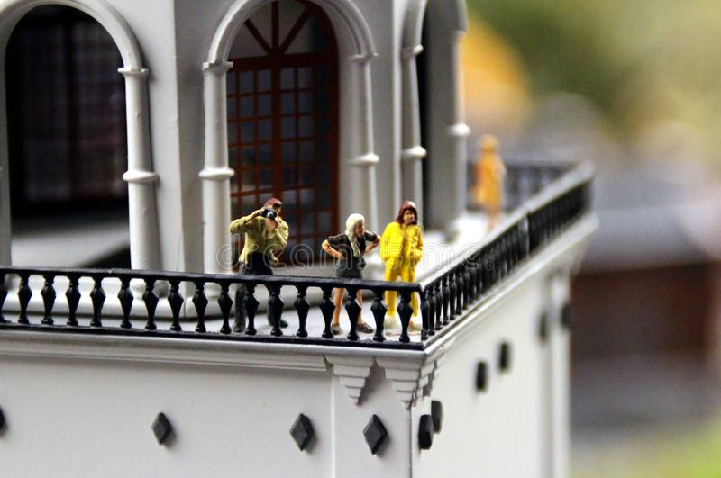 Tourists look from the observation deck of the bell tower macro. Collective image of cities and regions of the Russian Federation, made in miniature. National royalty free stock photos