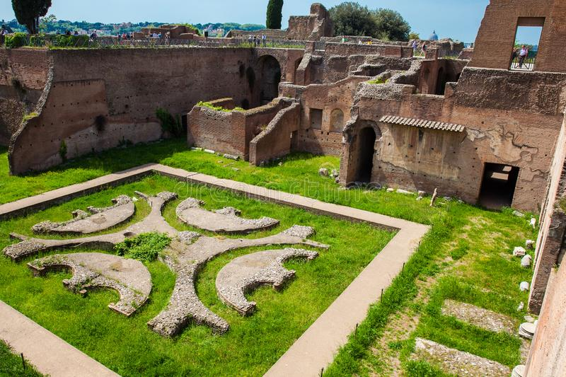 Tourists looking at the courtyard garden of the ancient ruins of the Domus Augustana on Palatine Hill stock photo