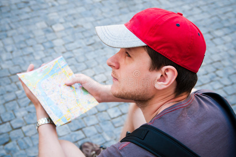Download Tourists looking at map stock image. Image of search - 21505325