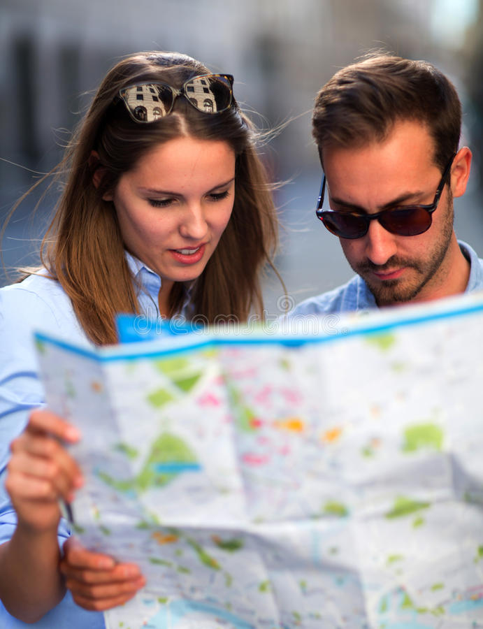 Download Tourists looking at a map stock image. Image of male - 26674377