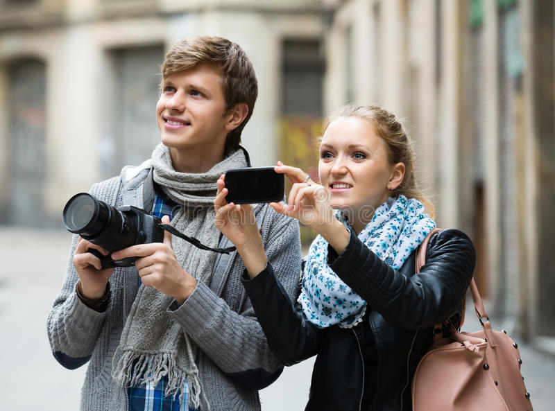 Tourists making photo at streets stock image