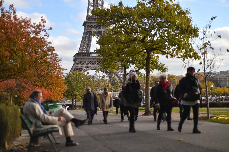 Tourists making photos in Trocadero site in an autumn day royalty free stock photography