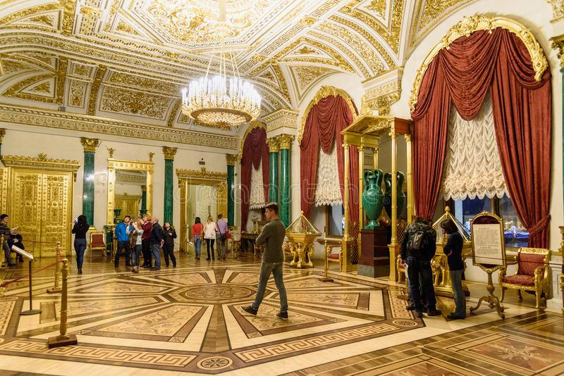 Tourists in the Malachite Room of State Hermitage Museum. Saint Petersburg. Russia. Saint Petersburg, Russia - January 3, 2018: Tourists in the Malachite Room of stock photo