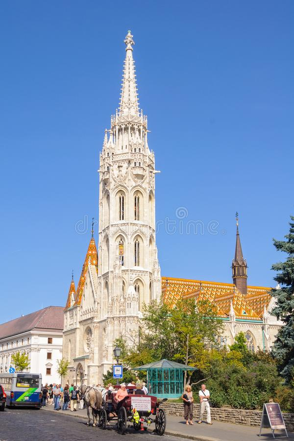 Matthias Church - Budapest. Tourists at the Matthias Church, one of the best known and most popular sights of Budapest, Hungary - 15 September 2011 stock image