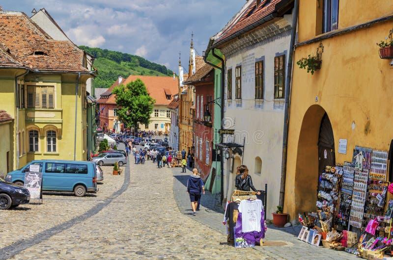 Tourists on medieval street in Sighisoara, Romania royalty free stock photo