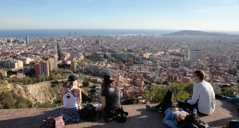 Tourists meet to watch Barcelona views from nearby hill. The city of Barcelona, dense residentials and office as commercial buildings, view from nearby hill of stock photos