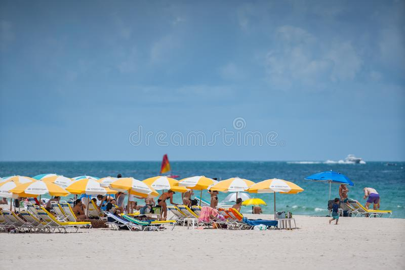 Tourists on Miami Beach. Getting ready for a day at the beach stock photo
