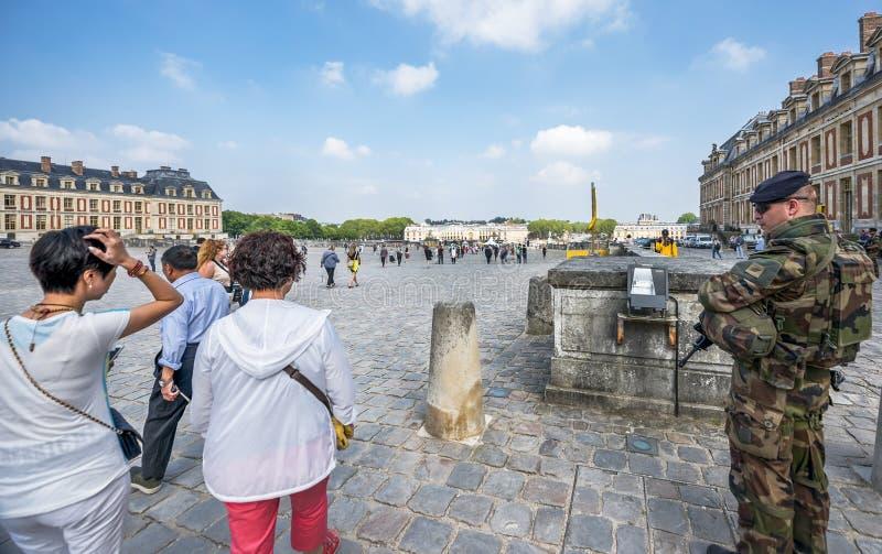 Military patrol at Versailles gardens. Tourists and military patrol in the garden of Versailles palace. France royalty free stock photos