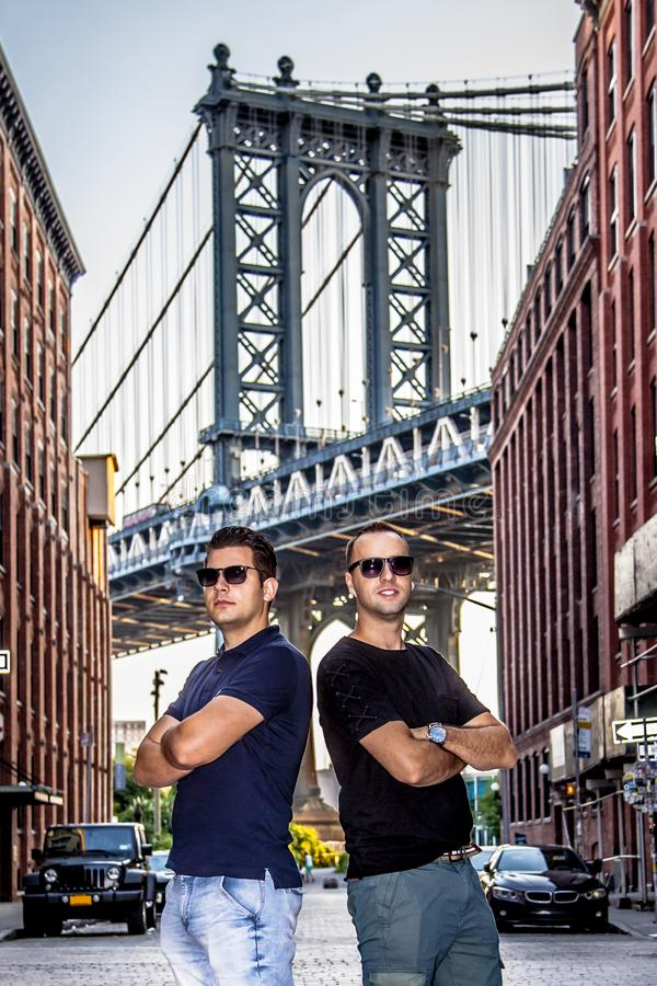 Tourists models enjoying New York City and Dumbo, Brooklyn. Tourists handsome models enjoying and Manhattan Bridge between Manhattan and Brooklyn over East River stock images