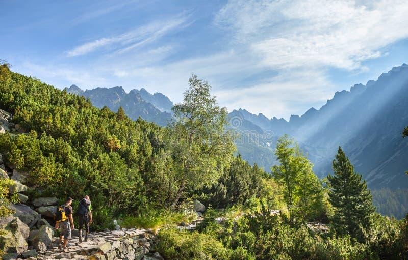 Tourists on mountain trail in High Tatra Mountains royalty free stock photo