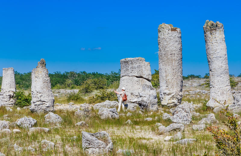 Tourists in the natural phenomenon Pobiti Kamani. Known as The Stone Forest and Dikilitash, natural landmark in a sacred place near Varna, Bulgaria royalty free stock photos