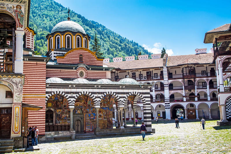 Tourists near the church in famous Rila Monastery, Bulgaria stock images