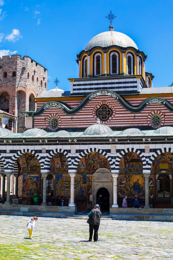 Tourists near the church in Rilsky monastery, Bulgaria stock photos