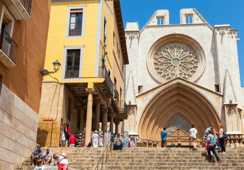 Tourists near the entrance to the Cathedral of Tarragona royalty free stock photo