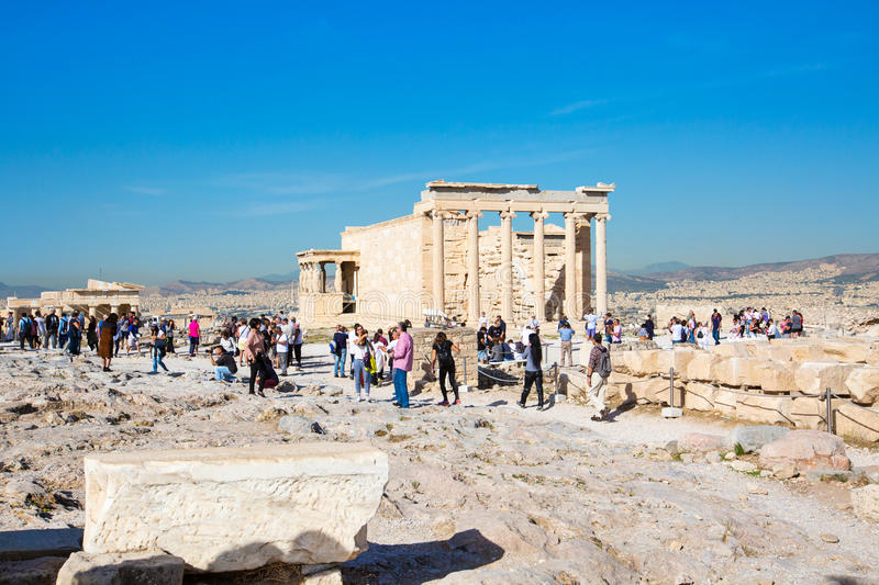 Tourists near Erechtheum temple ruins in Acropolis, Athens. Athens, Greece - October 14, 2016: Tourists near Erechtheum temple ruins decorated with Caryatids stock image