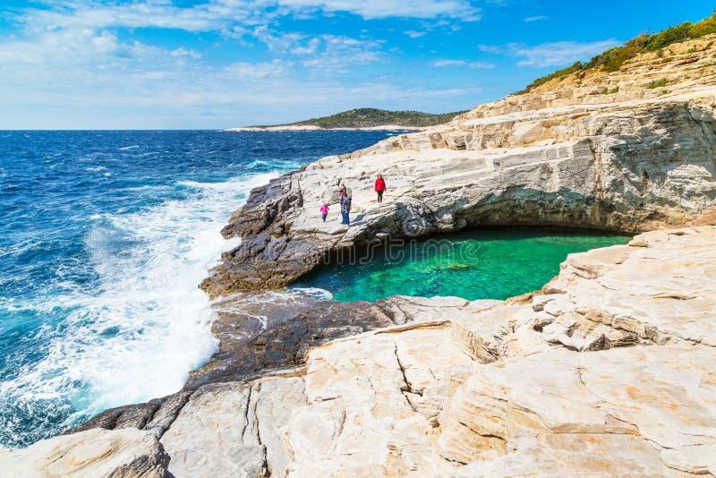 Tourists near Giola natural sea water pool, Thassos island, Greece stock photo