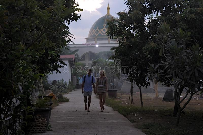 Tourists near a mosque in Gili Air Island Indonesia stock images