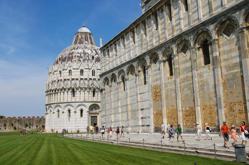 Tourists near the Pisa Cathedral on Piazza del Duomo, Italy stock photography