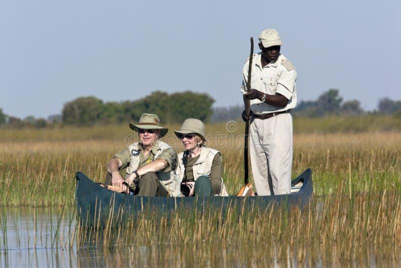 Tourists in the Okavango Delta - Botswana royalty free stock photography