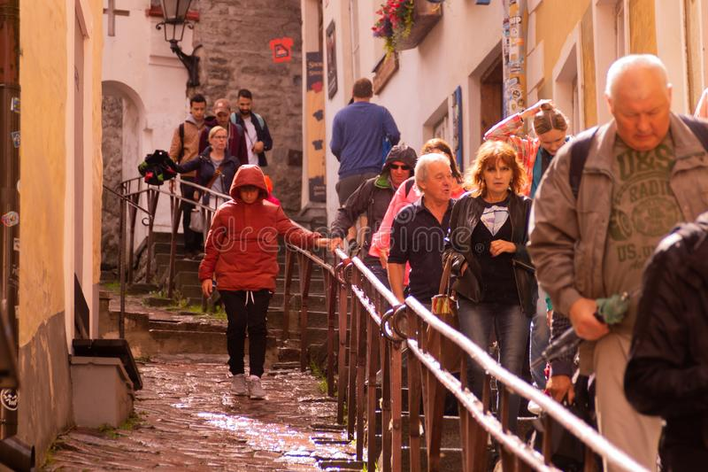 Tourists in the old city in Tallinn, Estonia royalty free stock photos