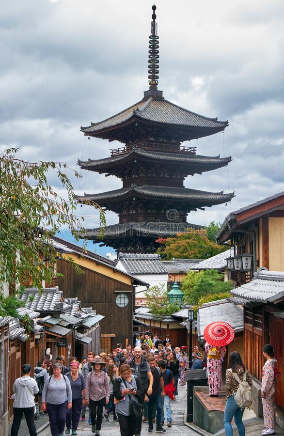 Tourists on the old Higashiyama street with the Hokan-ji Temple  on the background. Kyoto. Japan stock photos