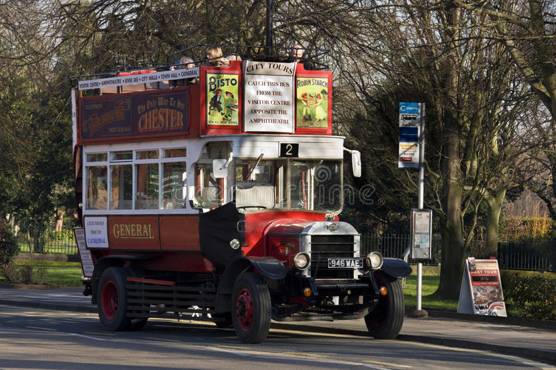 Tourists on an old open top bus - Chester - England royalty free stock image