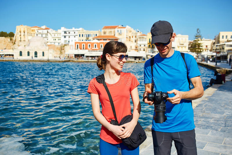 Tourists in the old town. Couple tourists walking in the old town. Couple in love, have Honeymoon on Crete, Greece stock photos