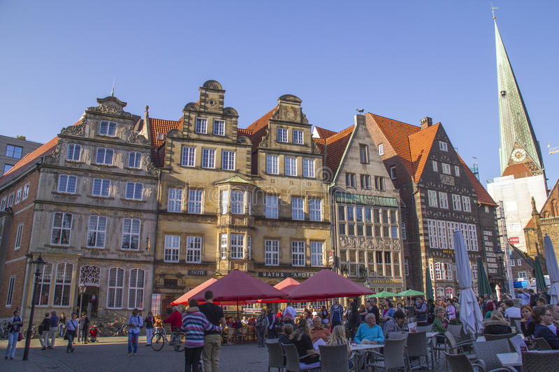 Tourists in Old town of Hanseatic city Bremen,Germany. BREMEN, GERMANY - OCTOBER 4, 2014: Tourists at the market place of Bremen, Germany UNESCO World Heritage royalty free stock image