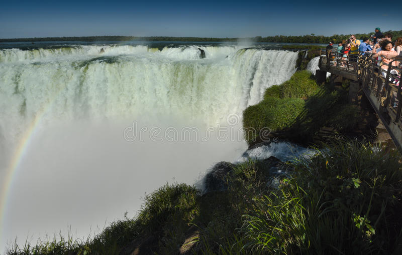 Tourists overlooking The Devils Throat - Iguasu Falls. MW - A platform for tourists overlooking the largest section of the Iguasu Falls is on the Brazilian side royalty free stock photos