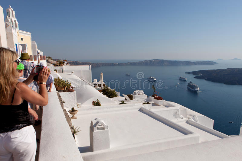 Tourists photograph the view of the caldera, Santorini island stock images