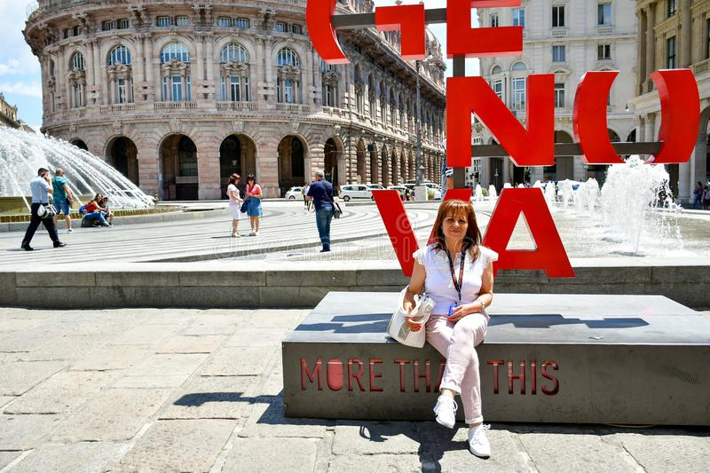 Tourists at Piazza De Ferrari ,Genoa , Italy. Piazza De Ferrari is the main square of Genoa. Situated in the heart of the city between the historical and the stock photo