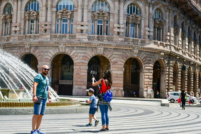 Tourists at Piazza De Ferrari ,Genoa , Italy. Piazza De Ferrari is the main square of Genoa. Situated in the heart of the city between the historical and the stock photography