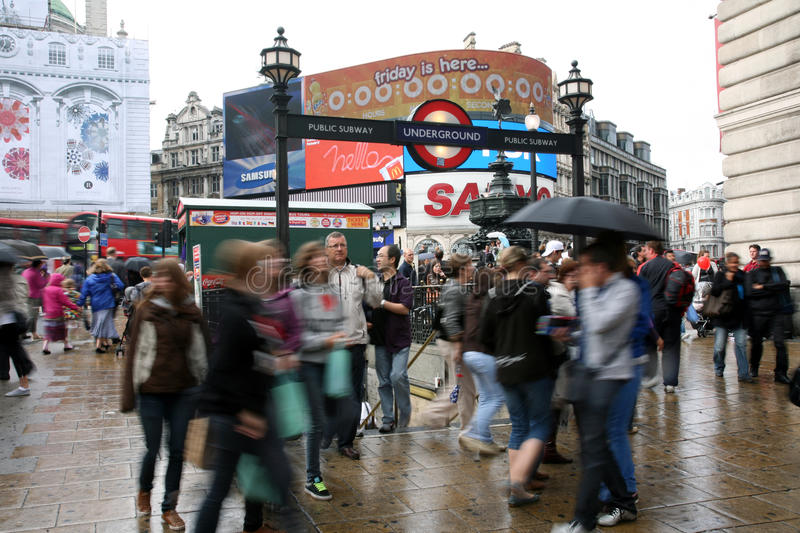 Download Tourists In Piccadilly Circus, 2010 Editorial Stock Image - Image: 24370659