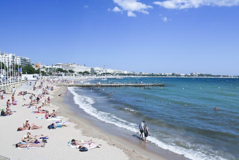 Tourists Plage de la Croisette Cannes Francia fotografia stock