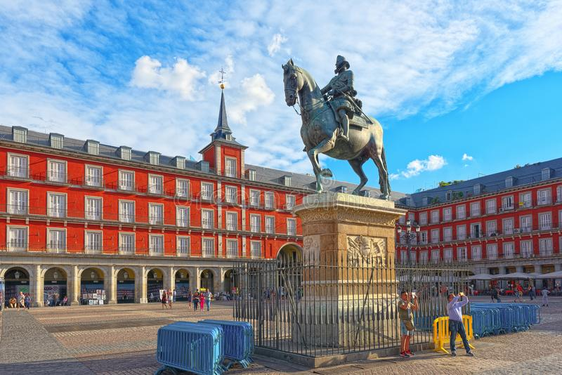 Tourists on Plaza Mayor.Bronze statue of King Philip III at the royalty free stock image