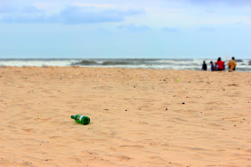 Tourists polluting beach, pollution concept royalty free stock photo