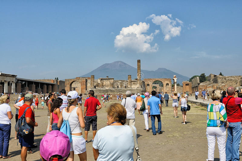 Tourists in Pompeii. Pompeii, Italy - September 14: Tourists visit the ruins of ancient city on September 14, 2011 in Pompeii. Pompeii was destroyed during royalty free stock images